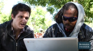 homeless man with a computer