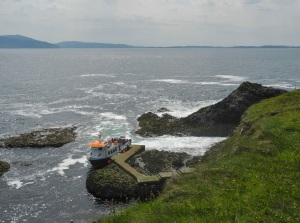 A larger ship than ours, boarding passengers at Staffa Pier.