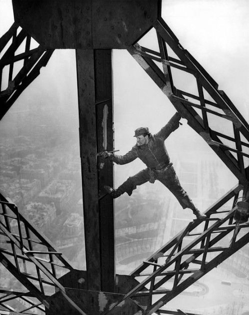Construction worker painting the Eifel Tower - March 28, 1953, CSU Archives, Everett Collection